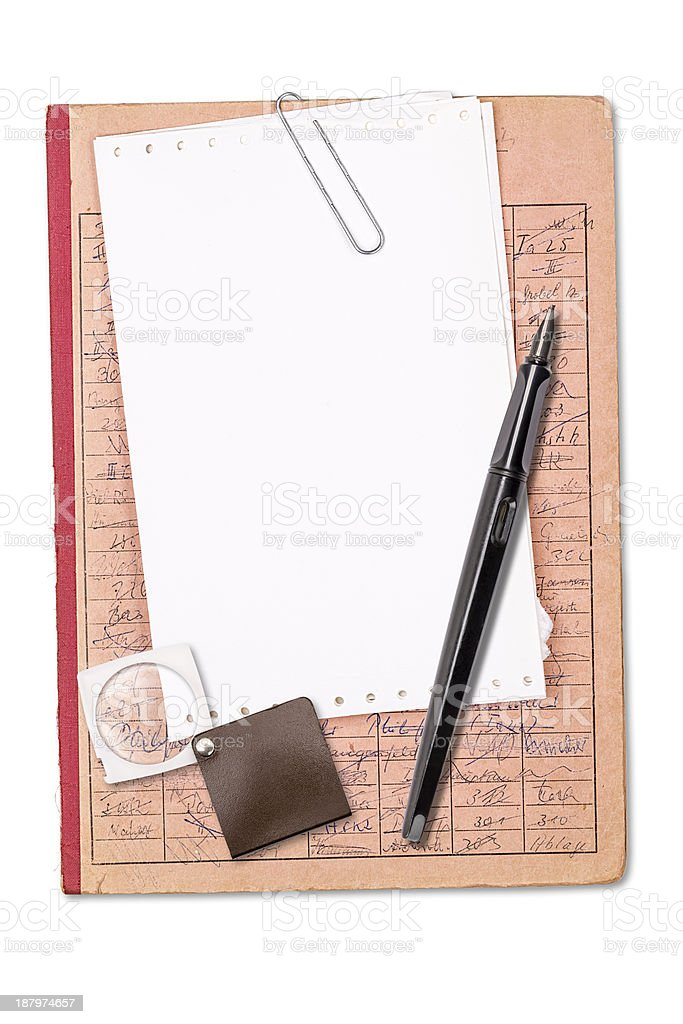 vintage record with blank sheet, pen and magnifier stock photo