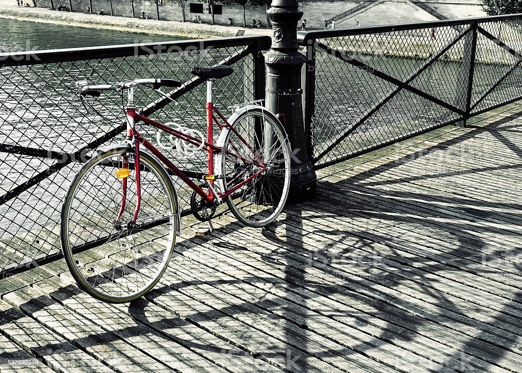 Vintage red bicycle in Paris stock photo