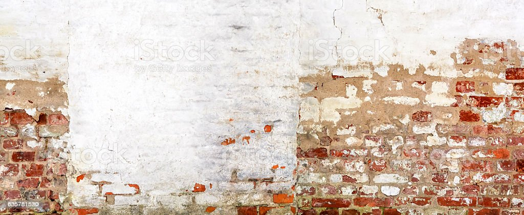 Vintage red brick Wall With Peeled Plaster. stock photo