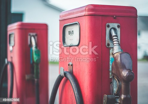 2 vintage fuel pumps sit outside of a non disclosed location