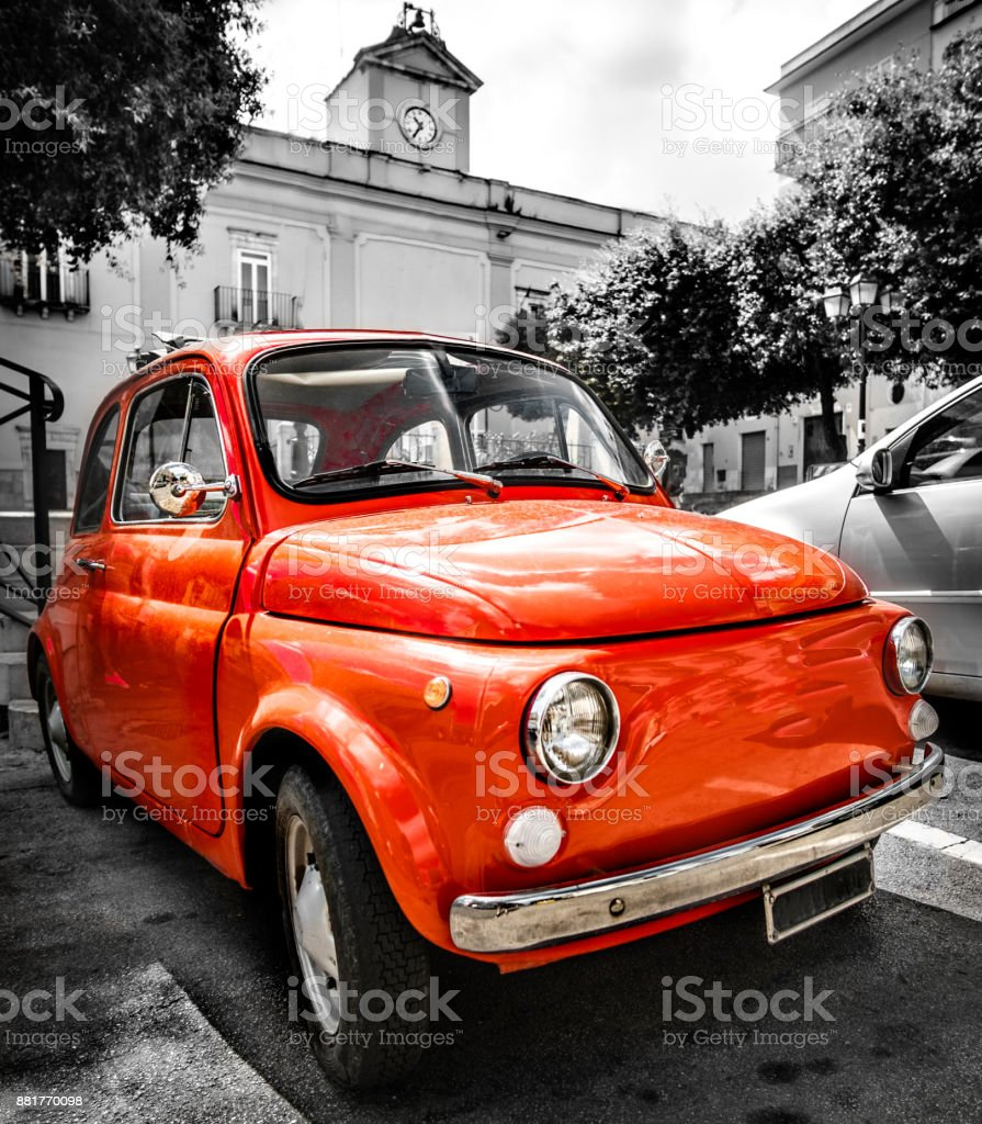 vintage red italian car old selective color black and white italy town stock photo