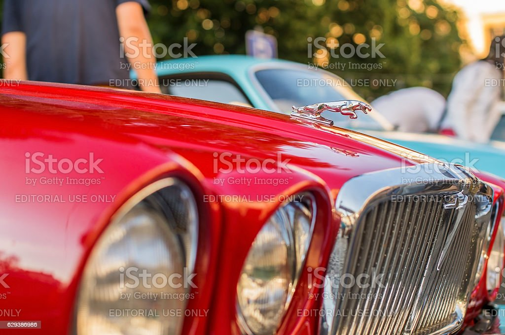 Vintage red Jaguar XJ12 Series III LVIV, UKRAINE - JUN 28, 2014: Vintage red Jaguar XJ12 Series III, released circa 1984 in Great Britain, parked on Market Square in Lviv, Ukraine. Car Stock Photo