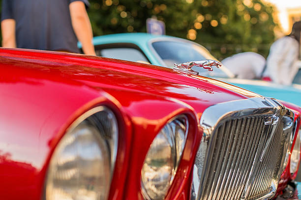 Vintage red Jaguar XJ12 Series III LVIV, UKRAINE - JUN 28, 2014: Vintage red Jaguar XJ12 Series III, released circa 1984 in Great Britain, parked on Market Square in Lviv, Ukraine. jaguar xj stock pictures, royalty-free photos & images