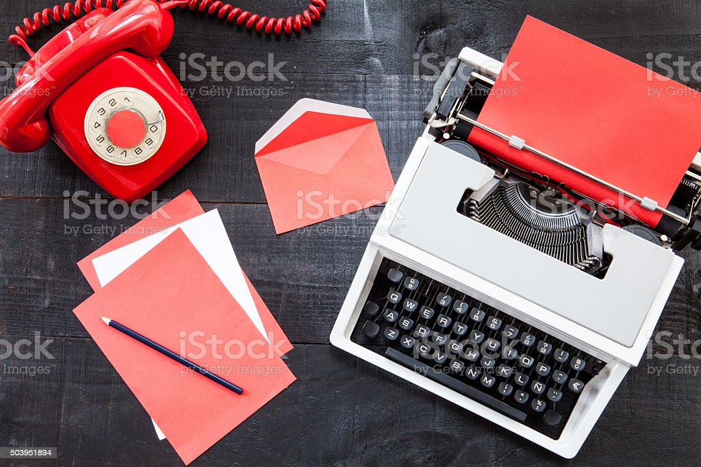 Vintage red office on wooden background stock photo