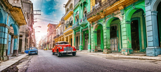 Vintage red oldtimer car driving through Havana Cuba stock photo