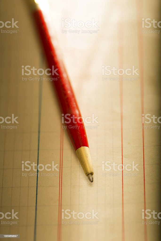 Vintage red pen on lined paper royalty-free stock photo
