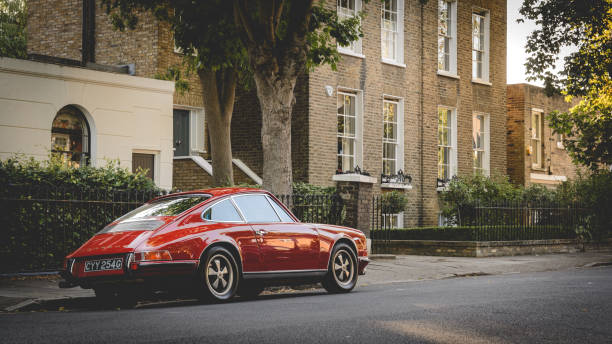Vintage red Porsche parked in a street. London, UK - July, 2015. Vintage red Porsche parked in a street of Canonbury in North London. porsche stock pictures, royalty-free photos & images