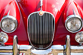 Ulm, Germany - April, 28th 2007: Front view of a vintge red sports car, 1958 Jaguar XK 150