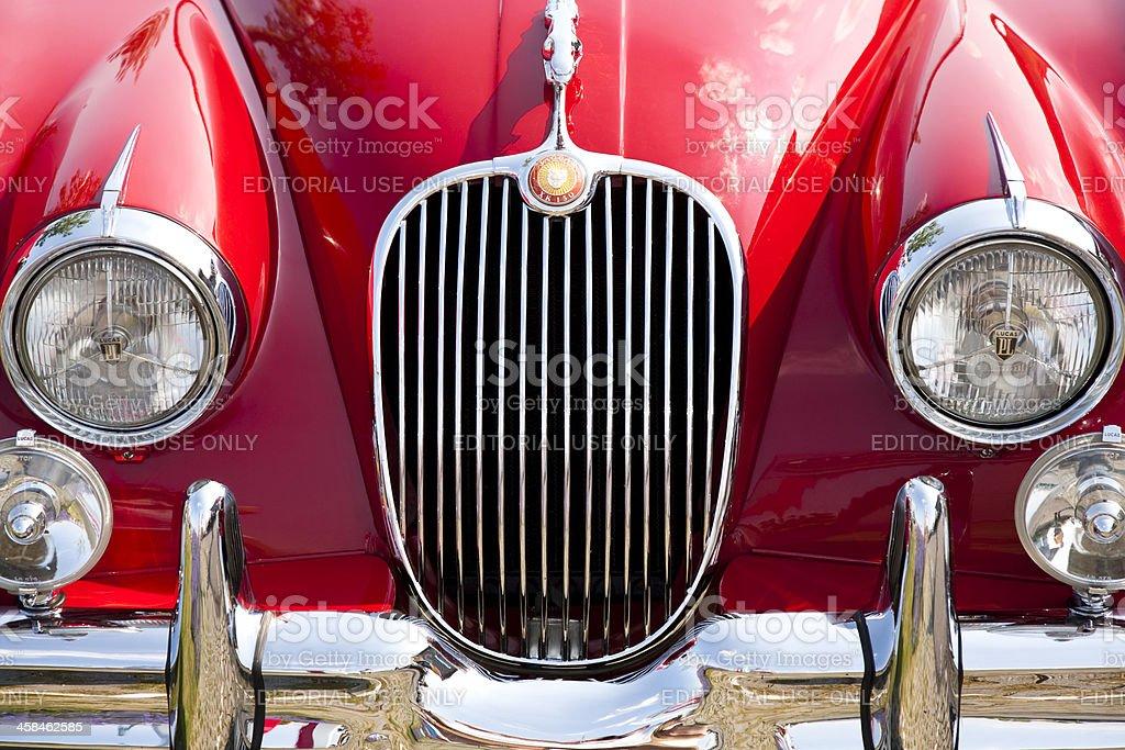Vintage red sports car front view, 1958 Jaguar XK 150 stock photo