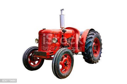 Vintage red tractor, isolated on white background.