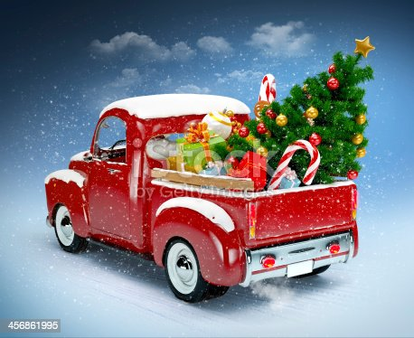 istock Vintage red truck with Christmas accessories in the back 456861995