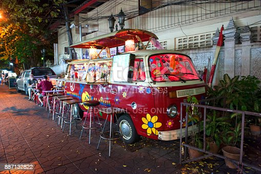 Bangkok, Thailand - February 25, 2015: A Vintage red Volkswagen Bus transformed in a mobile bar for serving refreshing drink to tourists.