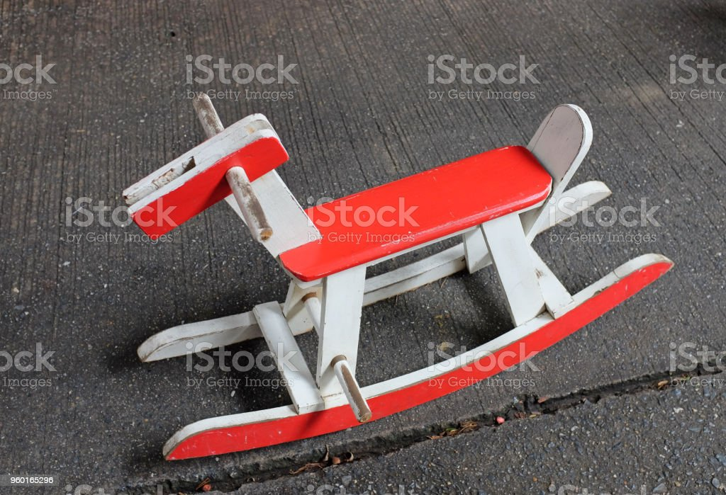 A Vintage Red Wooden Horse Rocking Chair Toy. Royalty Free Stock Photo