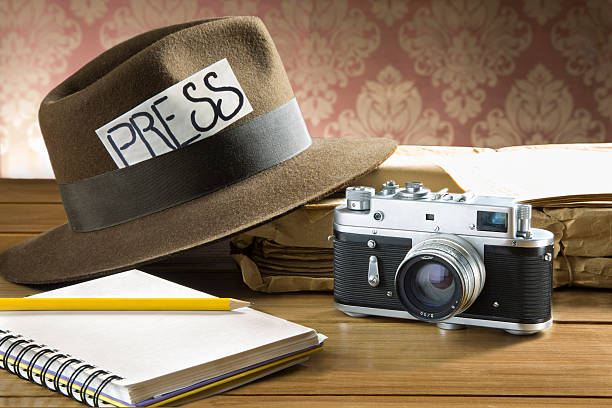 Vintage reporter fedora hat camera stock photo
