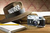 Vintage reporter fedora hat camera