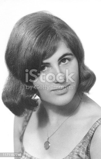 Vintage retro 1960s monochrome portrait of young woman/girl looking in camera