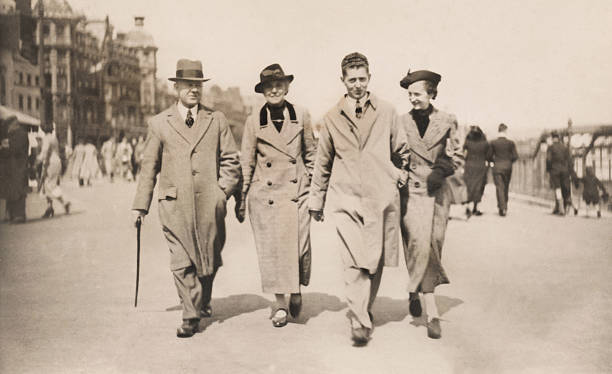 vintage / retro black-and-white image, 1930s family walking along weymouth promenade - 1930s style stock photos and pictures