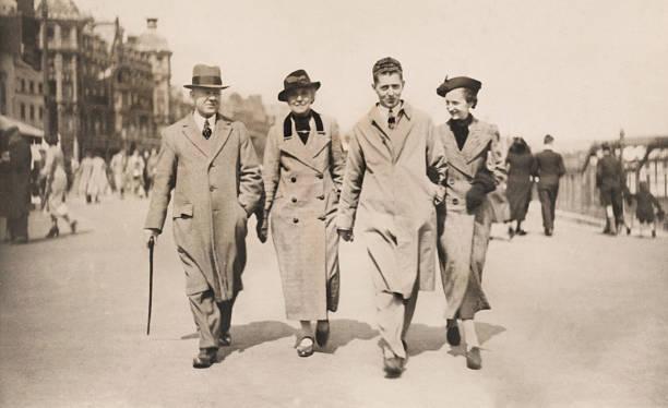 Vintage / retro black-and-white image, 1930s family walking along Weymouth promenade stock photo