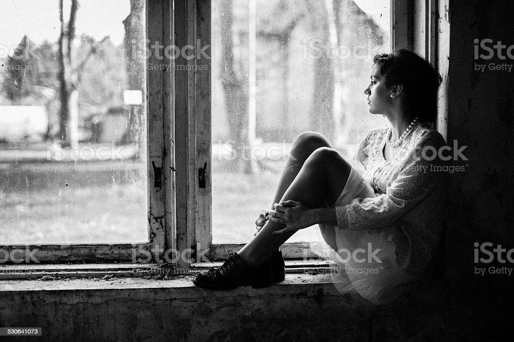 Vintage Retro Fashion Sad Nostalgic Woman Looking Through The Window Royalty Free Stock Photo
