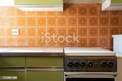 Vintage retro kitchen with orange pattern tiles, american retro kitchen home interior design 70's style close-up