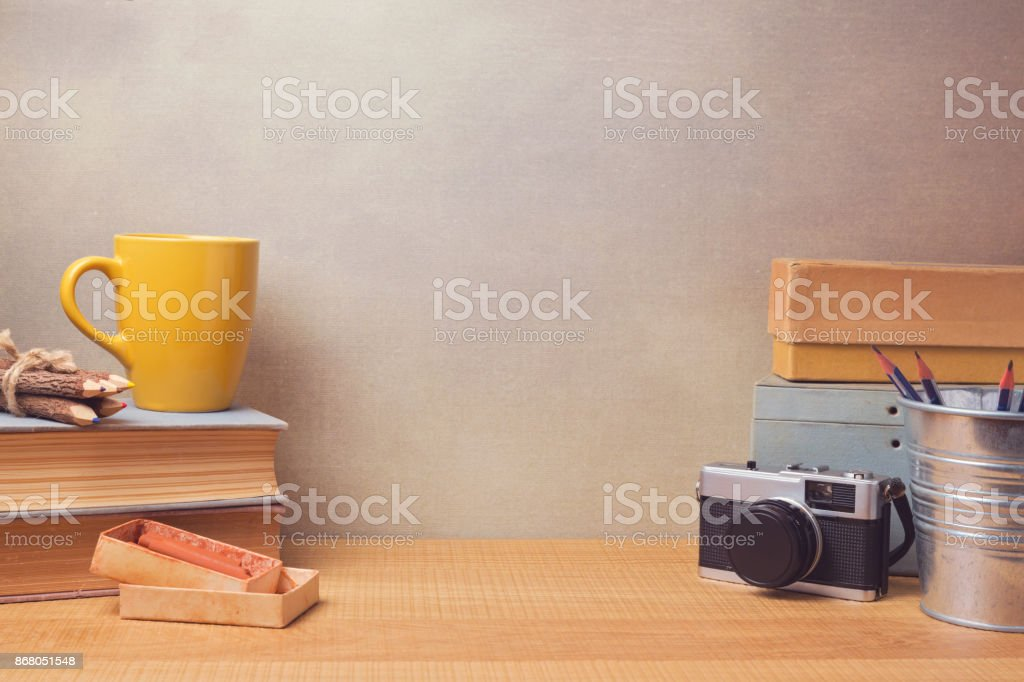 Vintage retro objects on wooden desk. Website hero image concept stock photo