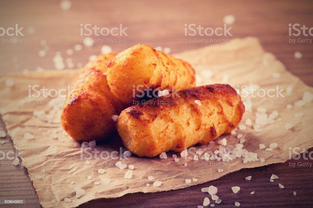 Vintage retro photo of fried potato croquettes stock photo