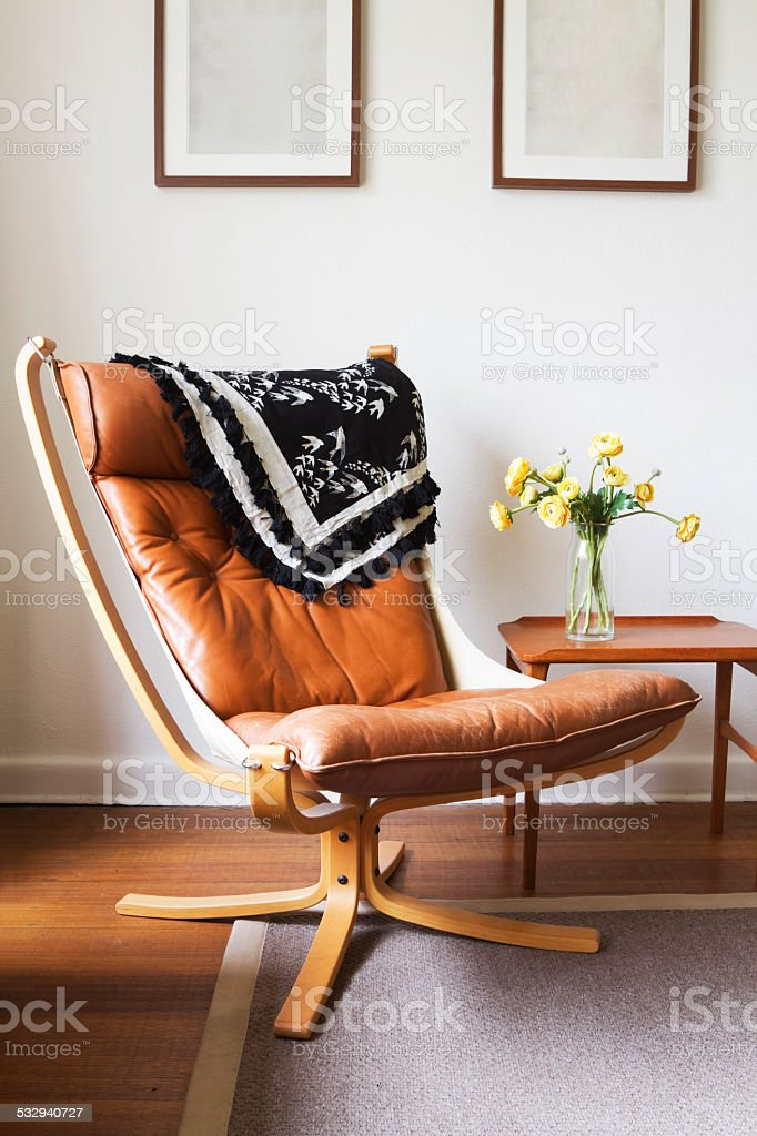 Vintage retro tan leather danish chair and table stock photo