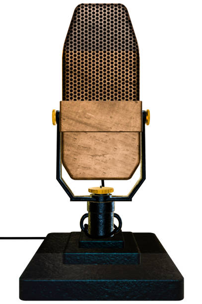 Vintage ribbon microphone on a table top stand with a white background stock photo