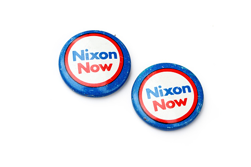 West Palm Beach, USA - October 22, 2014: Vintage Richard Nixon political campaign buttons. Richard Nixon was the 37th President of the United States and the only president to resign the office.