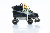 Vintage rolling skate isolated on white.