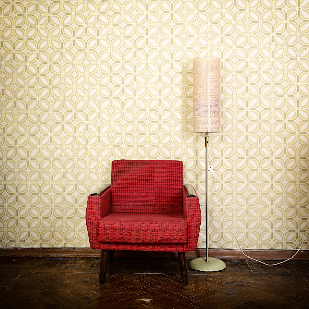 Vintage room with old fashioned armchair stock photo