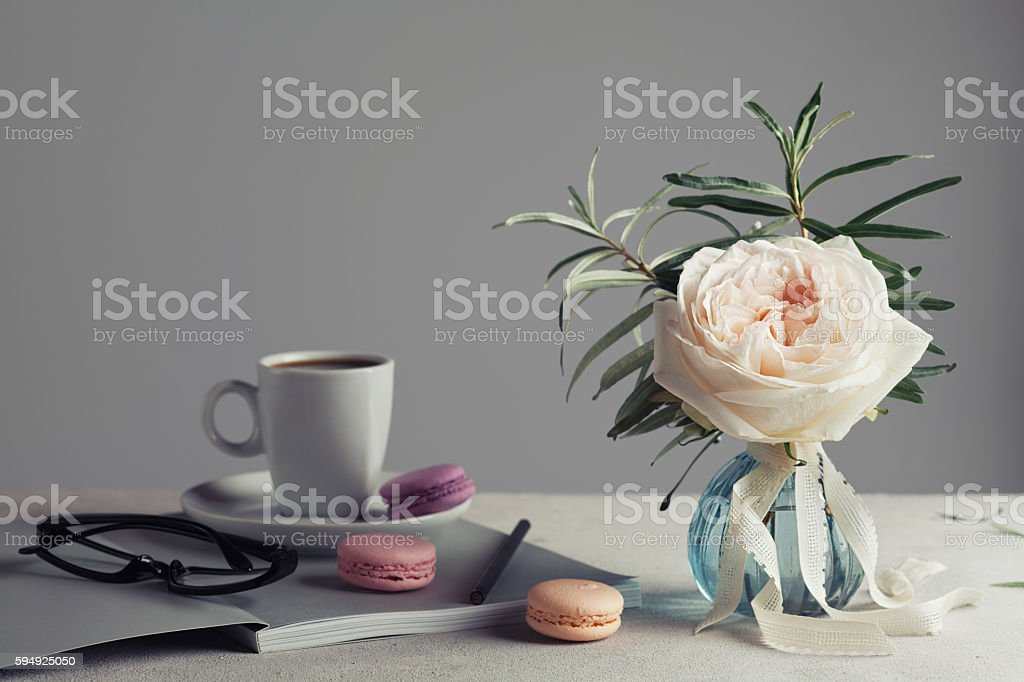 Vintage rose, coffee and macarons. Beautiful and cozy breakfast. stock photo