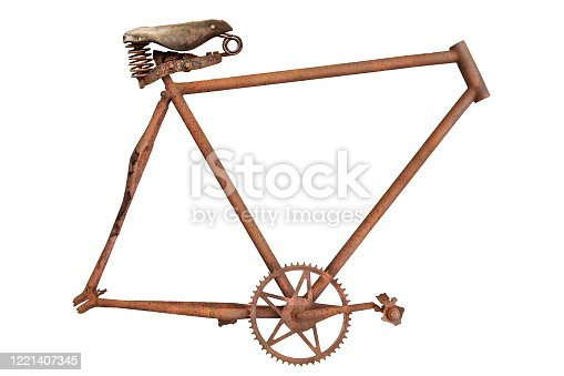 istock Vintage rusted and weathered bicycle frame with leather saddle isolated on white 1221407345