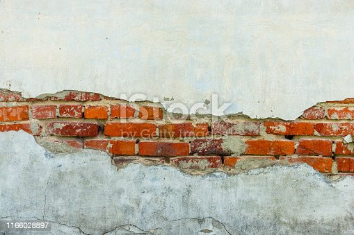 istock vintage rustic old red brick wall. some part cover with white clay with copy space 1166028897