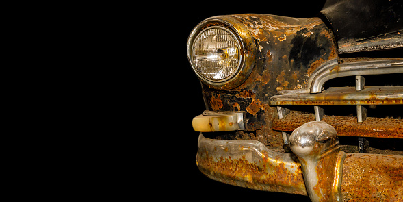 vintage rusty car isolated on black