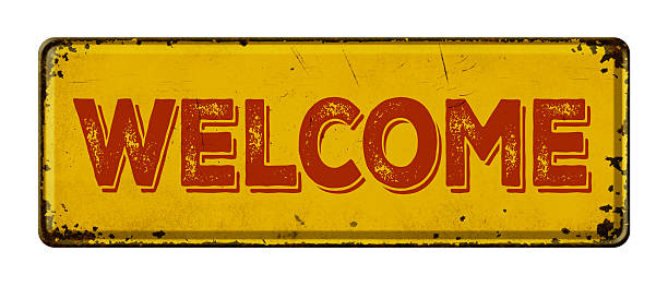 Vintage rusty metal sign on a white background - Welcome stock photo