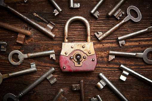 istock Vintage rusty padlock surrounded by old keys 614221002