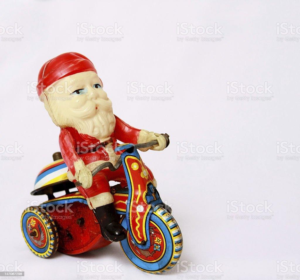 Vintage Santa Toy on Tin Motorcycle stock photo