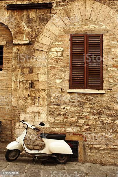Vintage scene of a stone wall wooden shudders and a moped picture id172275334?b=1&k=6&m=172275334&s=612x612&h=n53eburliqniifp8qezupa7klyfsbovbnhzqmiobi2k=