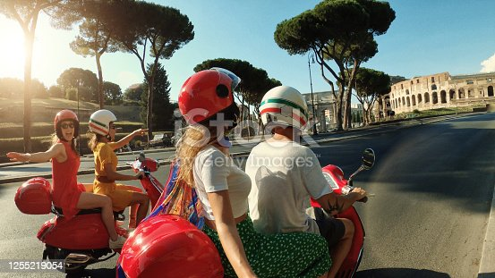 POV Selfie scooter riding: friends on the motorbikes in the center of Rome