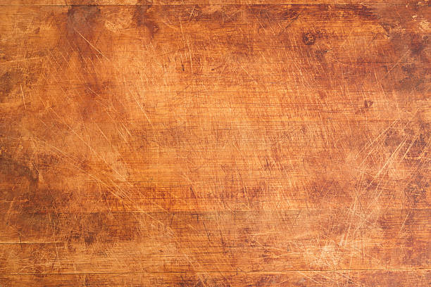 Vintage Scratched Wooden Cutting Board Vintage Scratched Wooden Cutting Board Background Texture cutting board stock pictures, royalty-free photos & images