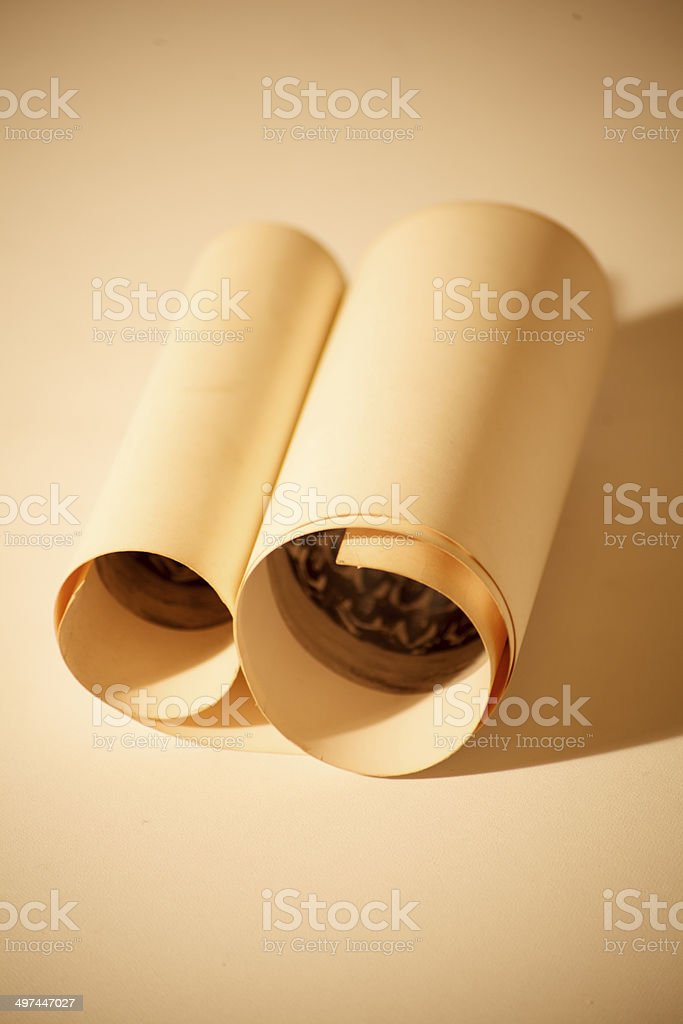 Vintage scroll against a sepia background stock photo