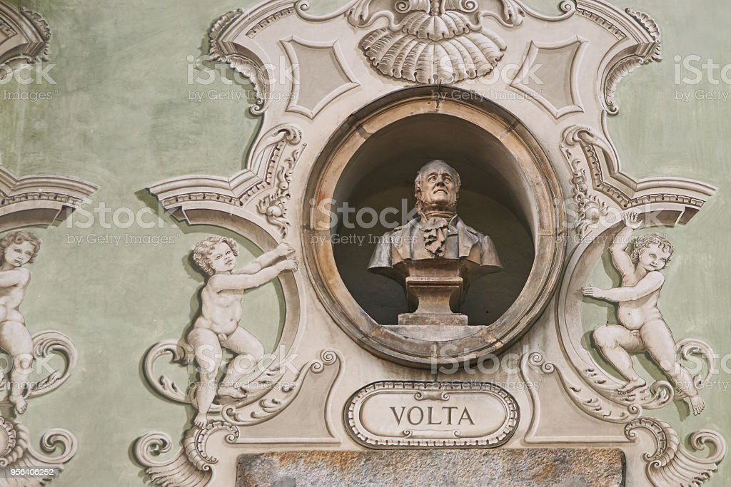 Vintage sculpture portrait of Alessandro Volta on a facade of an old building on Piazza Collegiata square in Bellinzona, Switzerland - foto stock