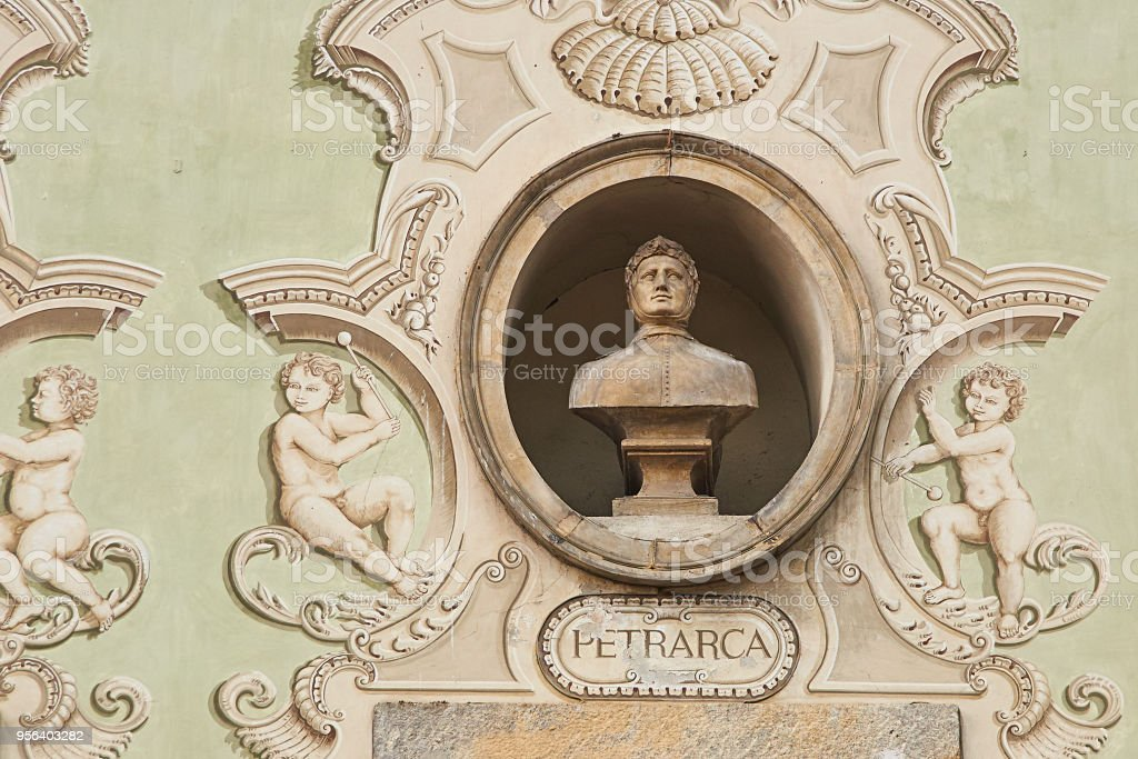 Vintage sculpture portrait of Francesco Petrarca on a facade of an old building on Piazza Collegiata square in Bellinzona, Switzerland - foto stock