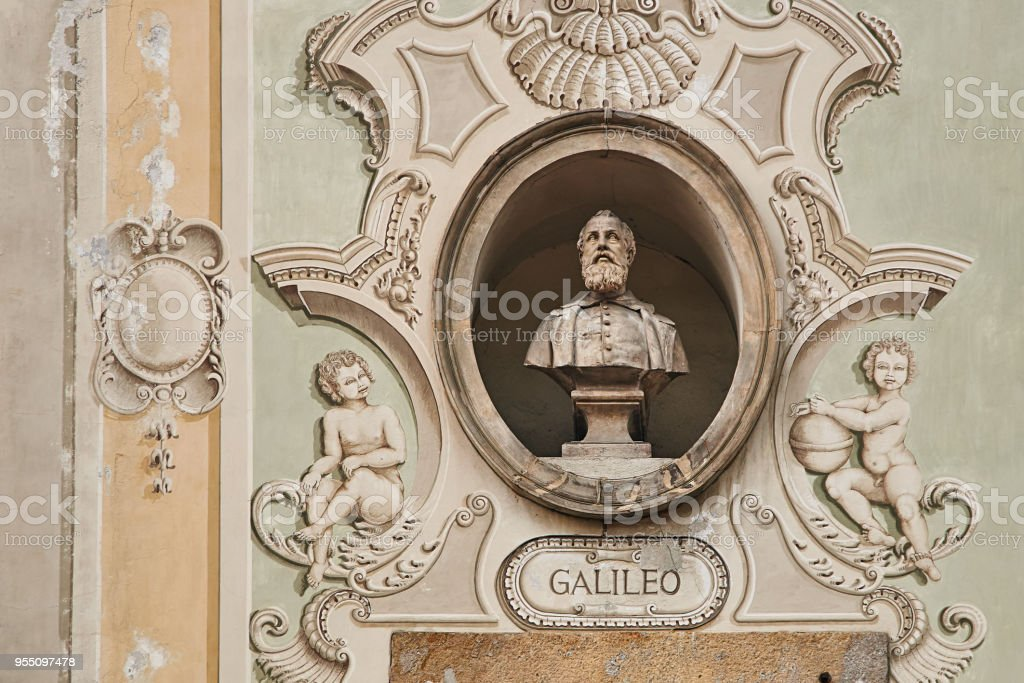 Vintage sculpture portrait of Galileo Galilei on a facade of an old building on Piazza Collegiata square in Bellinzona, Switzerland - foto stock
