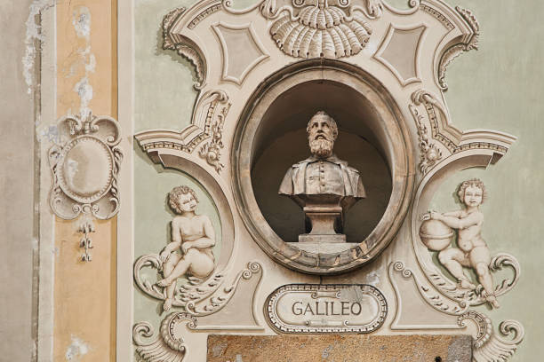 Vintage sculpture portrait of Galileo Galilei on a facade of an old building on Piazza Collegiata square in Bellinzona, Switzerland Vintage sculpture portrait of Galileo Galilei, a famous polymath on a facade of an old building on Piazza Collegiata square in Bellinzona, Switzerland galileo galilei stock pictures, royalty-free photos & images