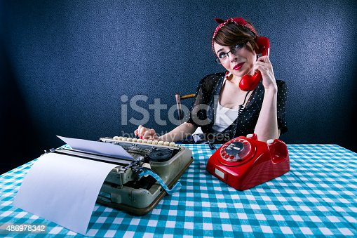 471445335istockphoto Vintage Secretary on the Phone 486978342