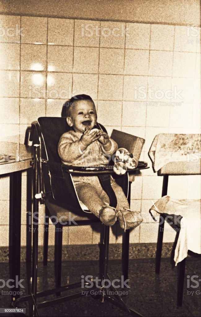 Vintage sepia toned image of baby laughing stock photo