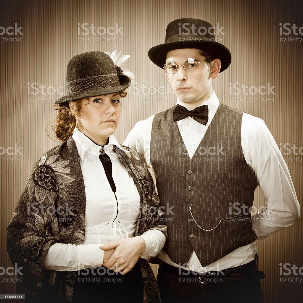 vintage sepia toned love couple portrait in elegant wear stock photo