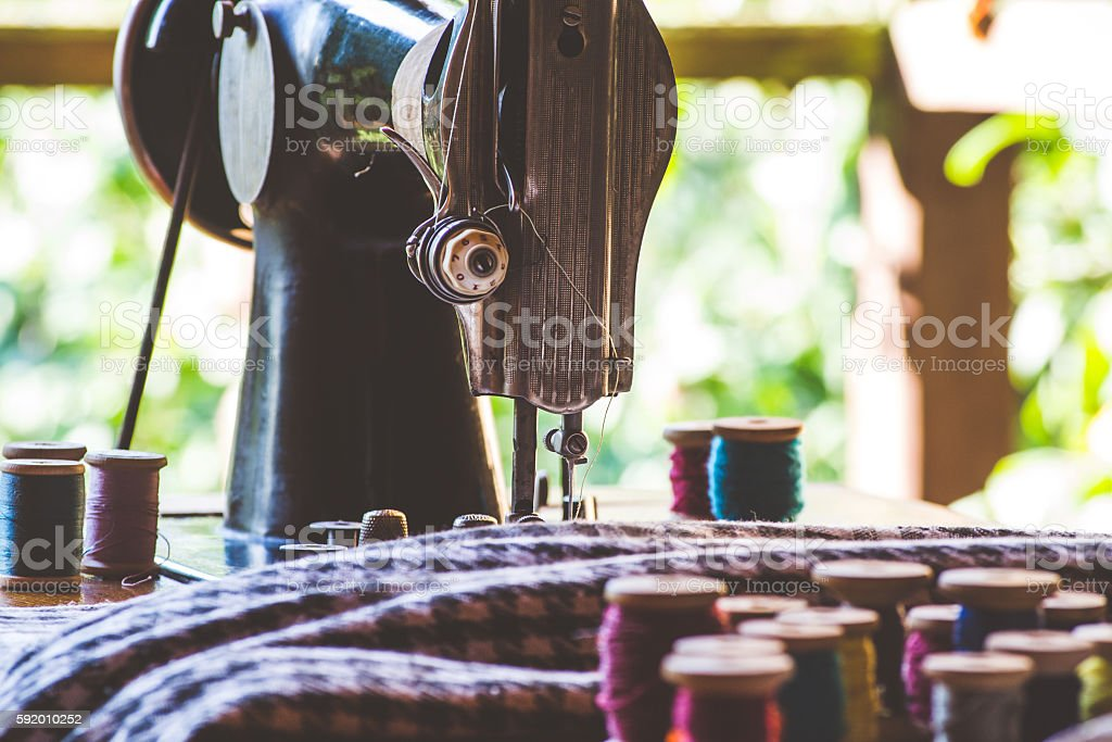 Vintage sewing machine and other sewing tools stock photo